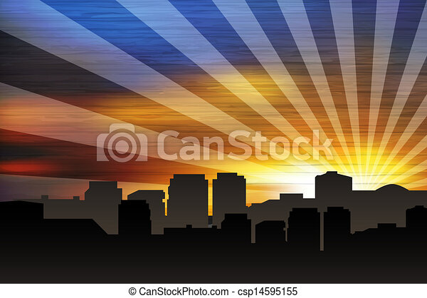 Cityscape at sunset with sunrays - csp14595155