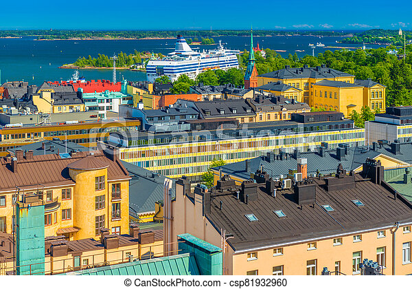 Cityscape of Helsinki, Finland. Colorful houses of the biggest Finnish city. Panorama with a Cruise liner and The Baltic Sea with numerous Islands - csp81932960