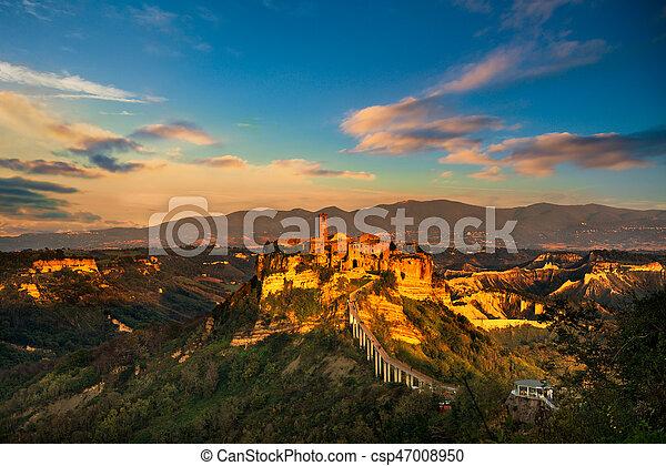 Civita di Bagnoregio landmark, aerial panoramic view on sunset. Italy - csp47008950