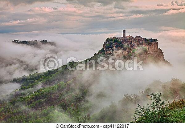 Civita di Bagnoregio, Viterbo, Lazio, Italy: landscape at dawn with fog - csp41122017