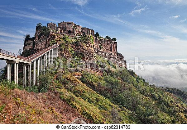 Civita di Bagnoregio, Viterbo, Lazio, Italy: landscape of the ancient village founded in Etruscan time on the steep tuff hill - csp82314783