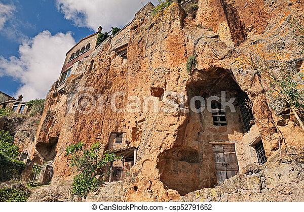 Civita di Bagnoregio, Viterbo, Lazio, Italy: the rock face of the tuff hill with caves and rock-cut cellars - csp52791652