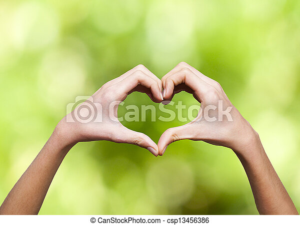 clasped hands forming a heart with  - csp13456386
