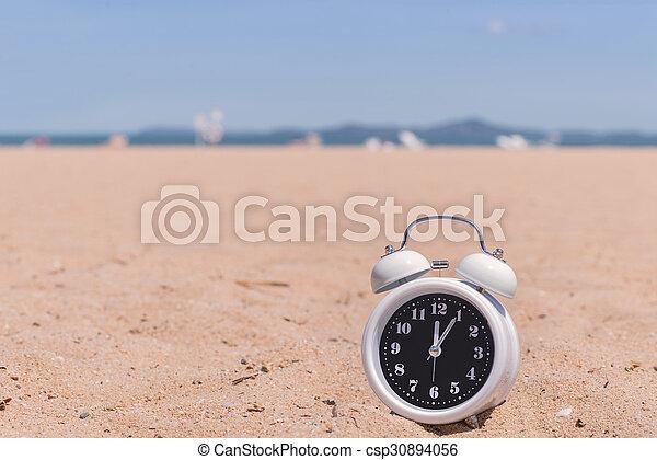 Classic analog clocks in sand on the beach - csp30894056