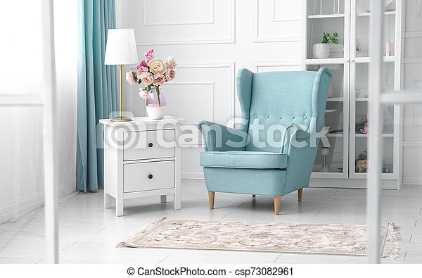 Classic blue and white theme living room - light blue armchair in white room