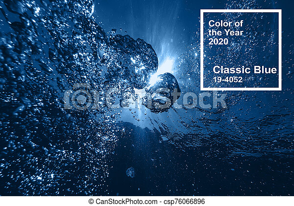 Classic blue pantone main color trend of the Year 2020. air bubbles at water surface in sea in clear blue water - csp76066896