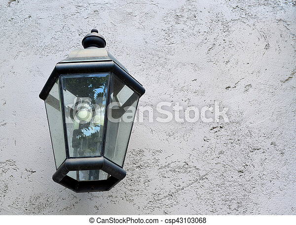 Classic lamp hanging on cement wall - csp43103068