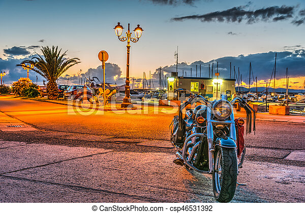 Classic motorcycle in Alghero harbor - csp46531392