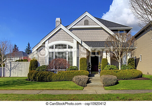 Classic New American House Exterior In The Spring.   Csp10920412