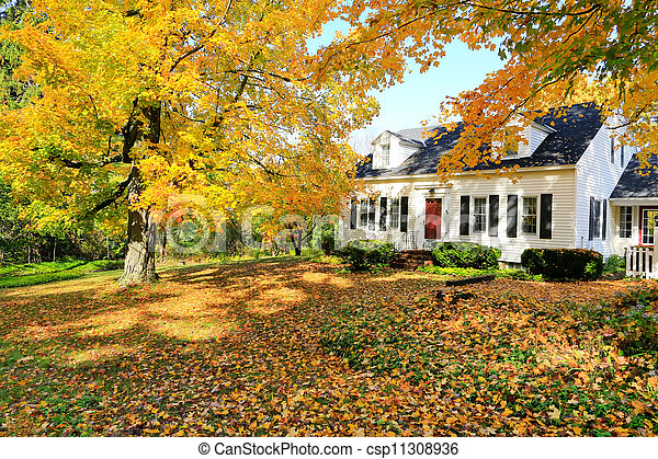 Classic New England American House Exterior During Fall. Stock Photo