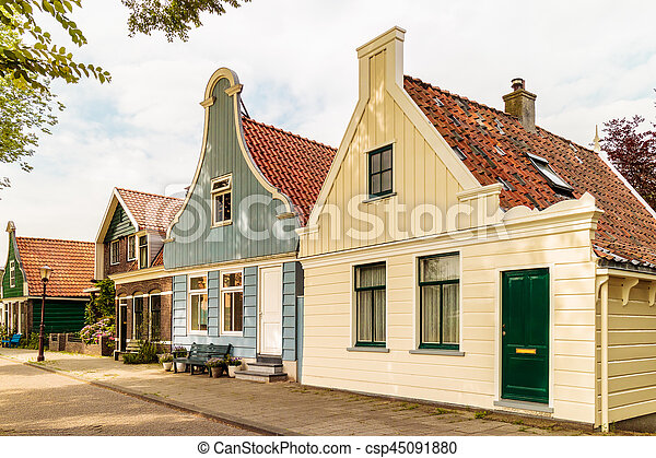 Classic Old Wooden Dutch Houses In North Amsterdam Street With