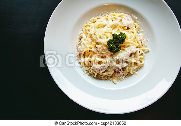 Classic Pasta carbonara Italian with Parmesan Cheese on black background - csp42103852