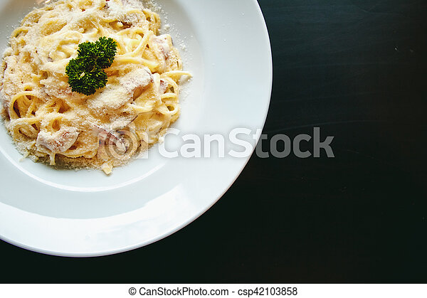Classic Pasta carbonara Italian with Parmesan Cheese on black background - csp42103858
