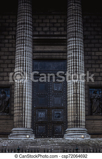 Classical antic columns at the front of the pantheon in Paris - csp72064692