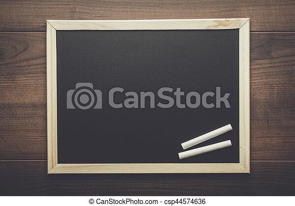 clean blackboard and chalk - csp44574636