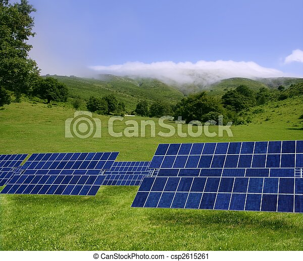 Clean electric energy solar plates in meadow - csp2615261