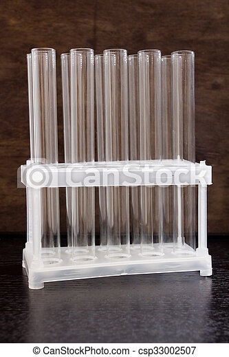 Clean glass tubes in a plastic stand - csp33002507