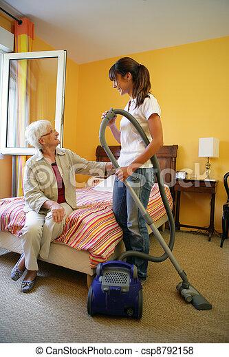 Cleaner vacuuming bedroom - csp8792158
