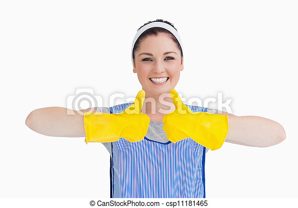 Cleaner woman thumbs up with yellow gloves - csp11181465