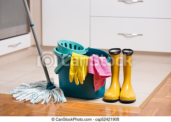 Cleaning equipment on kitchen floor. Mop and bucket with other ...