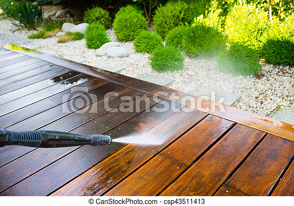 cleaning terrace with a pressure washer - csp43511413