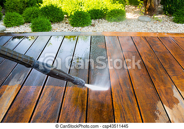 cleaning terrace with a pressure washer - csp43511445