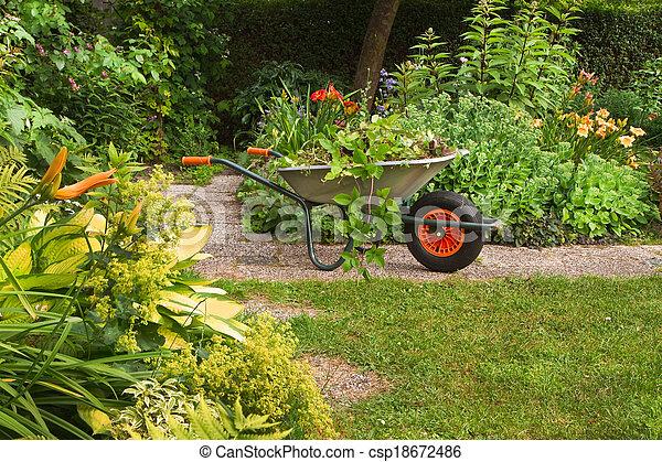 Cleaning up garden in summer - csp18672486