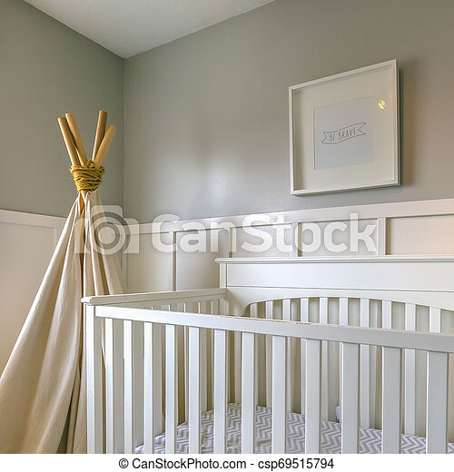 Clear Square Interior of a room for children with white wooden crib and play teepee - csp69515794