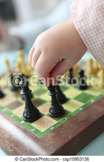 Clever little girl playing chess - csp10953136