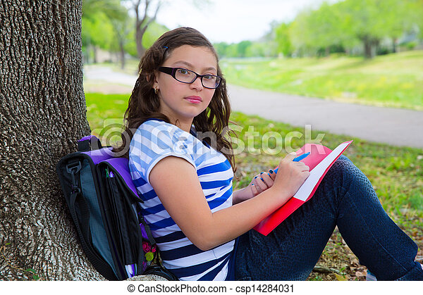 Clever student teen girl with school bag under park tree - csp14284031