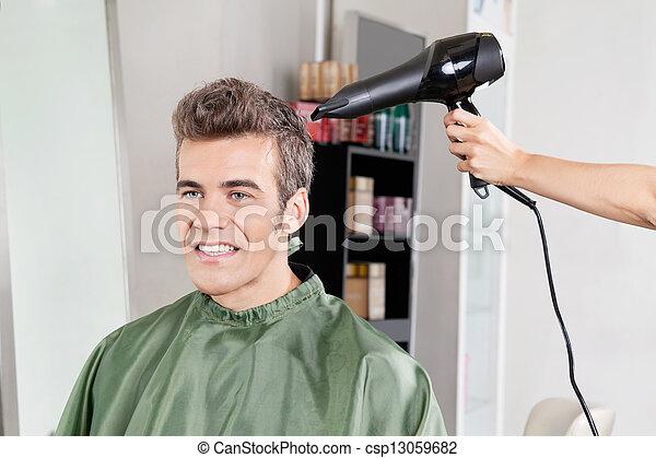 Client Gets His Hair Dried In Salon - csp13059682
