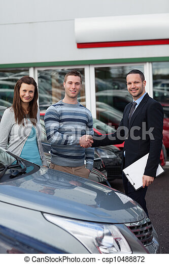 Client shaking the hand of a man - csp10488872