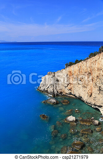 Cliff blue sea and horizon Lefkada Greece - csp21271979