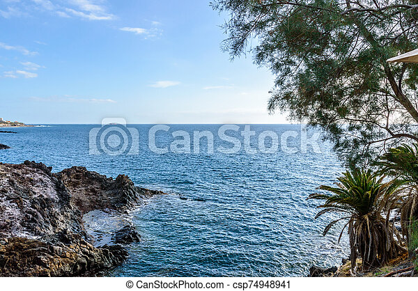 Cliff With A Privileged View Of The Infinite Ocean At Sunset Playa De Las Americas. April 11, 2019. Santa Cruz De Tenerife Spain Africa. Travel Tourism Street Photography. - csp74948941