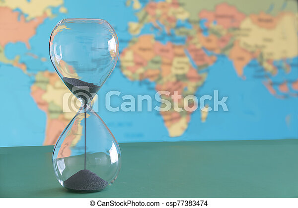Climate change with time running out as depicted by a hour glass . - csp77383474