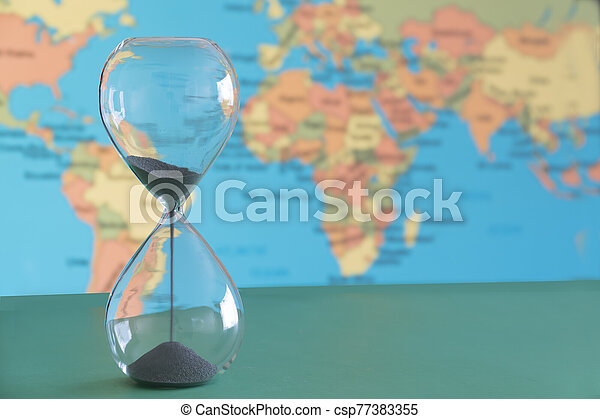 Climate change with time running out as depicted by a hour glass . - csp77383355