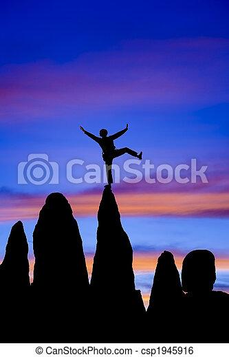 Climber balances on the summit. - csp1945916