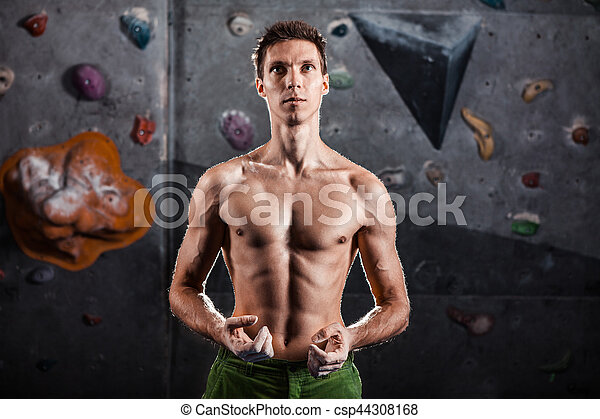 Climber man getting ready for climb - csp44308168