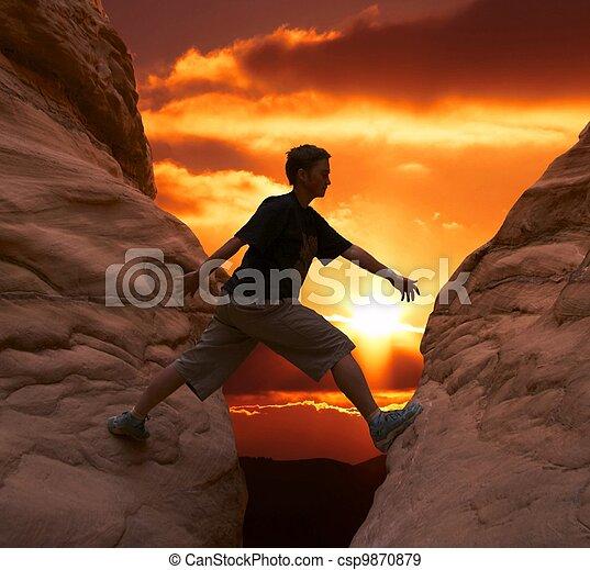 Climber on sunset - csp9870879