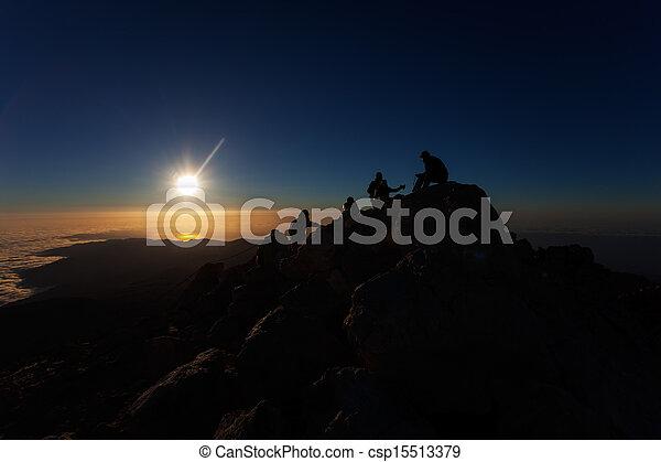 climbers at sunrise - csp15513379