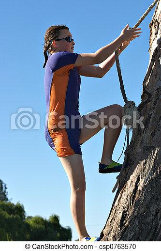 climbing a tree - csp0763570