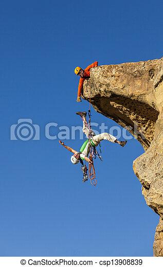 Climbing team struggles to the summit. - csp13908839