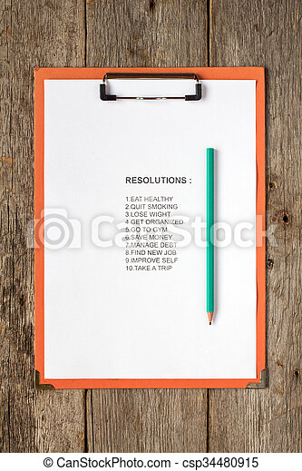 Clipboard with pencil and resolutions - csp34480915