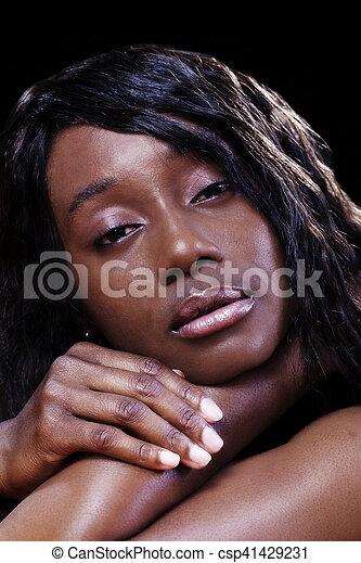 Close Portrait Attractive African American Woman Dark Background - csp41429231