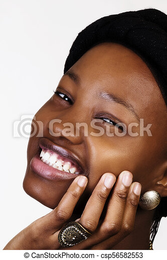 Close Smiling Portrait Young African American Woman With Hand - csp56582553