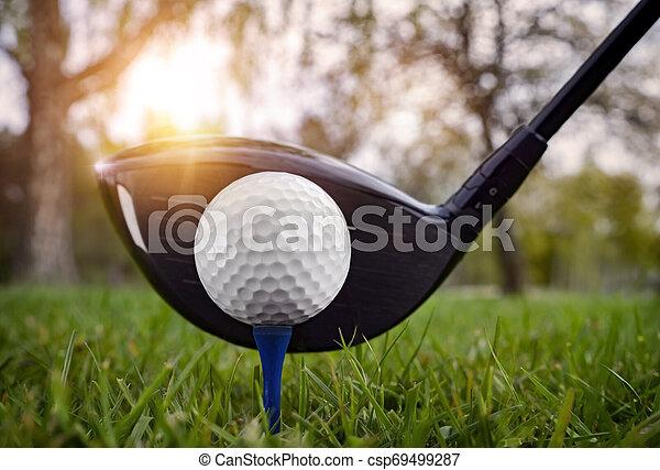 Close up at golf club and golf ball - csp69499287
