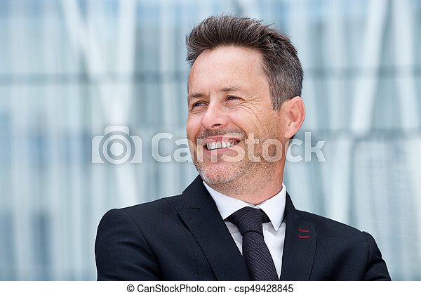 Close up attractive businessman smiling in suit and tie - csp49428845