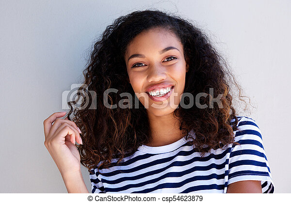 Close up attractive young african american woman smiling against white background - csp54623879