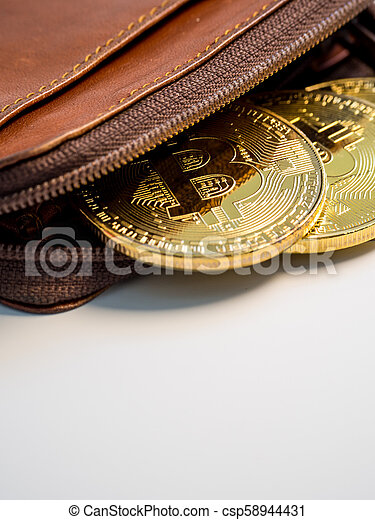 Close up bitcoin gold coins with wallet on the white background. Virtual cryptocurrency concept. - csp58944431