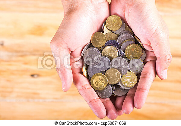 Close up coins in hand - csp50871669